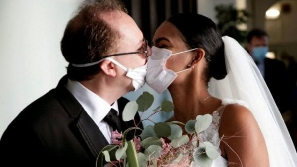 Now is the winter of our post-lockdown life... /img/newlyweds-with-masks.jpg