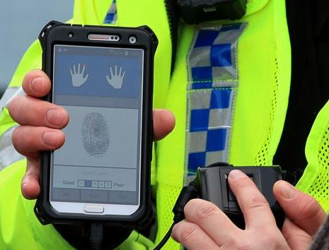 The next three titles about cops with fingerprint scanners /img/uk-police-fingerprint-scanner.jpg